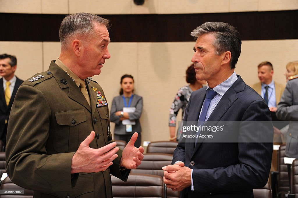 Secretary General Anders Fogh Rasmussen (R) attends the second day of the NATO Defense Ministers meeting at NATO headquarters in Brussels, Belgium on June 4, 2014.