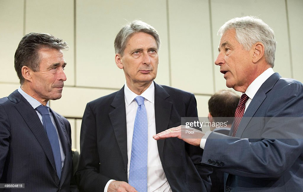 Secretary General Anders Fogh Rasmussen (L), British Secretary of State for Defense Philip Hammond (C) and U.S. Defense Secretary Chuck Hagel (R) at a meeting of the NATO-Georgia Commission at NATO headquarters on June 4, 2014 in Brussels, Belgium. NATO defense ministers met with their Georgian counterparts on Wednesday to discuss security and cooperation issues.