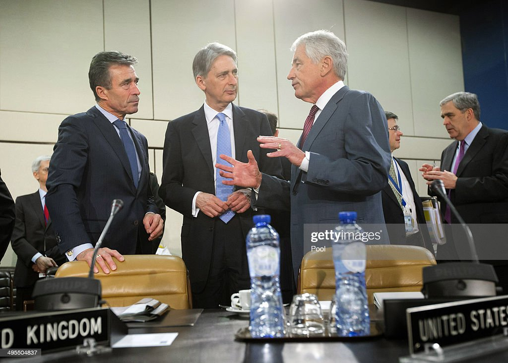 Secretary General <a gi-track='captionPersonalityLinkClicked' href=/galleries/search?phrase=Anders+Fogh+Rasmussen&family=editorial&specificpeople=549374 ng-click='$event.stopPropagation()'>Anders Fogh Rasmussen</a> (L), British Secretary of State for Defense <a gi-track='captionPersonalityLinkClicked' href=/galleries/search?phrase=Philip+Hammond&family=editorial&specificpeople=2486715 ng-click='$event.stopPropagation()'>Philip Hammond</a> (C) and U.S. Defense Secretary <a gi-track='captionPersonalityLinkClicked' href=/galleries/search?phrase=Chuck+Hagel&family=editorial&specificpeople=504963 ng-click='$event.stopPropagation()'>Chuck Hagel</a> (R) at a meeting of the NATO-Georgia Commission at NATO headquarters on June 4, 2014 in Brussels, Belgium. NATO defense ministers met with their Georgian counterparts on Wednesday to discuss security and cooperation issues.