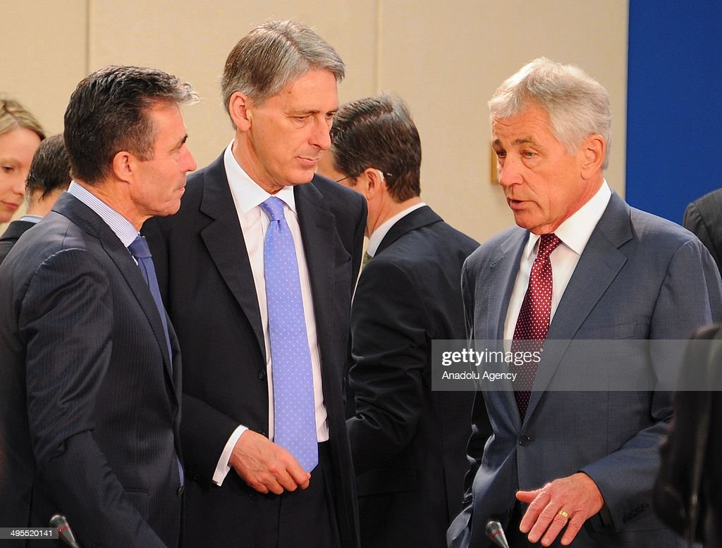 Secretary General Anders Fogh Rasmussen (L), British Secretary of State for Defense Philip Hammond (C), and U.S. Defense Secretary Chuck Hagel (R) chat during the second day of defence ministers meeting in Brussels, Belgium on June 4, 2014. NATO defense ministers met with their Georgian counterparts on Wednesday to discuss security and cooperation issues.