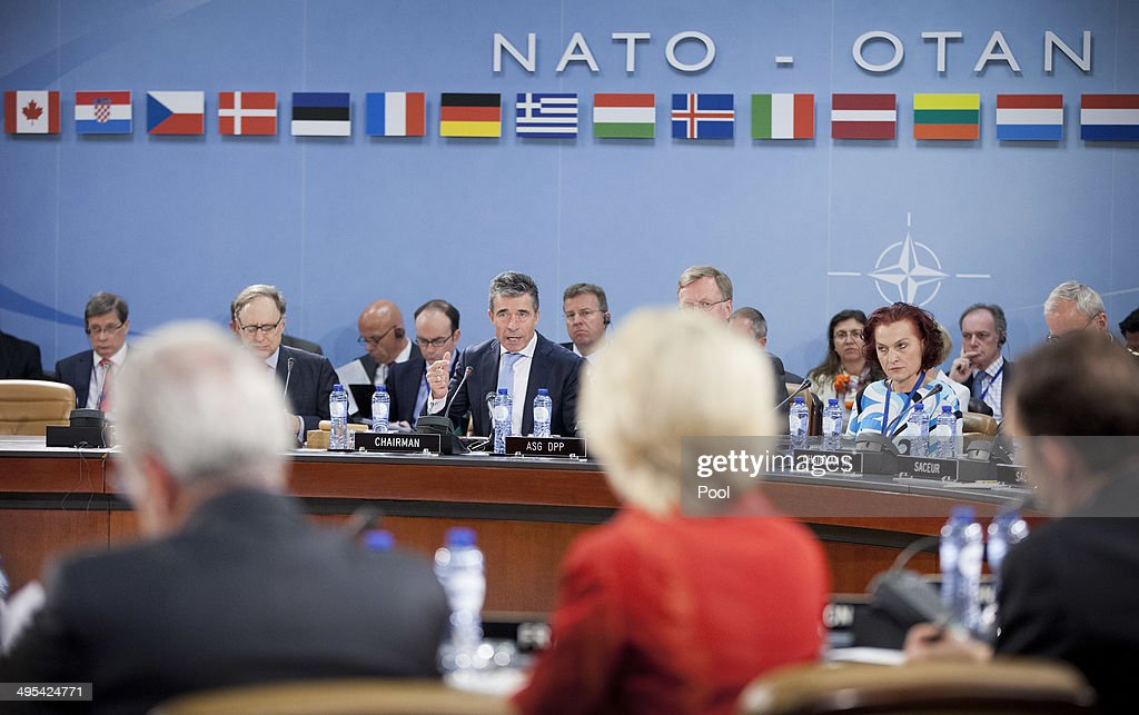 Secretary General Anders Fogh Rasmussen, center, gives opening remarks during the start of a meeting of the North Atlantic Council at NATO headquarters on June 3, 2014 in Brussels, Belgium. NATO defense ministers are meeting for the first time since the crisis in Ukraine and will consider their response to Russia's military occupation and annexation of Crimea.