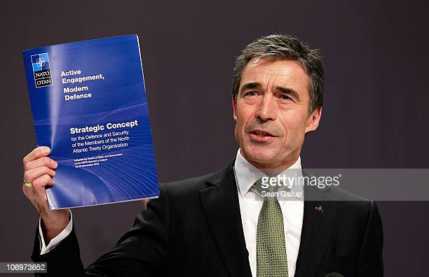 Secretary General Anders Fogh Rasmussen holds the new strategic concept during the press conference of day 1 of the NATO Summit 2010 at Feira...