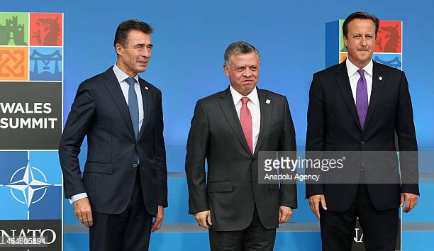 Secretary General Anders Fogh Rasmussen Jordan's King Abdullah and British Prime Minister David Cameron pose for photogtaphers before the NATO Summit...