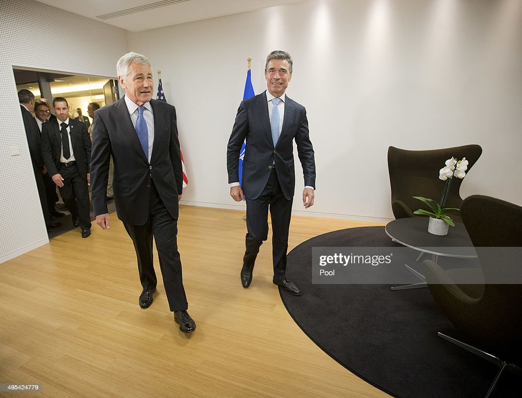 Secretary General Anders Fogh Rasmussen, right, walks with U.S. Defense Secretary Chuck Hagel, left, before the start of their joint meeting at North Atlantic Council (NATO) on June 2, 2014 in Brussels, Belgium. NATO defense ministers are meeting for the first time since the crisis in Ukraine and will consider their response to Russia's military occupation and annexation of Crimea.