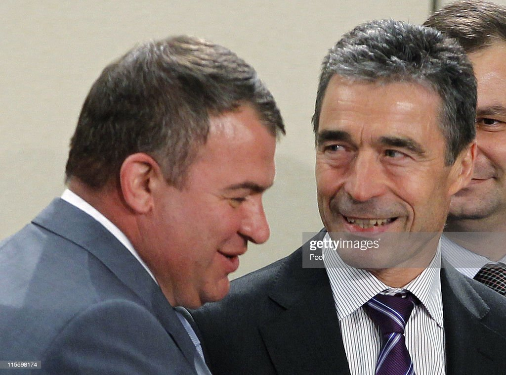 Secretary General <a gi-track='captionPersonalityLinkClicked' href=/galleries/search?phrase=Anders+Fogh+Rasmussen&family=editorial&specificpeople=549374 ng-click='$event.stopPropagation()'>Anders Fogh Rasmussen</a> (R) speaks with Russia's Defence Minister <a gi-track='captionPersonalityLinkClicked' href=/galleries/search?phrase=Anatoly+Serdyukov&family=editorial&specificpeople=4162784 ng-click='$event.stopPropagation()'>Anatoly Serdyukov</a> during a meeting of the NATO-Russia Council at the NATO Defence Ministers Summit on June 8, 2011 in Brussels, Belgium. Gates arrived for NATO talks after a two-day farewell trip in Afghanistan before he steps down as U.S. Secretary of Defense.