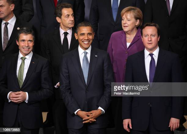 Secretary General Anders Fogh Rasmussen stands with French President Nicolas Sarkozy US President Barack Obama German Chancellor Angela Merkel and...