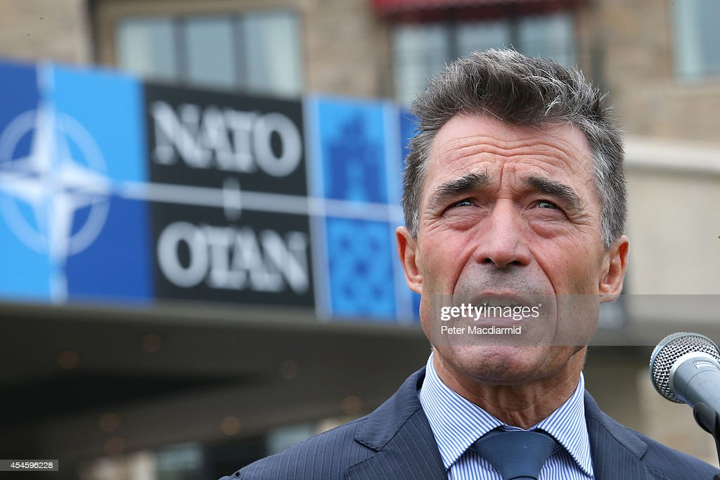 Secretary General <a gi-track='captionPersonalityLinkClicked' href=/galleries/search?phrase=Anders+Fogh+Rasmussen&family=editorial&specificpeople=549374 ng-click='$event.stopPropagation()'>Anders Fogh Rasmussen</a> talks to reporters at the NATO Summit on September 4, 2014 in Newport, Wales. Leaders and senior ministers from around 60 countries are gathering for the two day meeting where Ukraine and the ISIS hostages are likely to be discussed.
