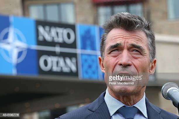 Secretary General Anders Fogh Rasmussen talks to reporters at the NATO Summit on September 4 2014 in Newport Wales Leaders and senior ministers from...