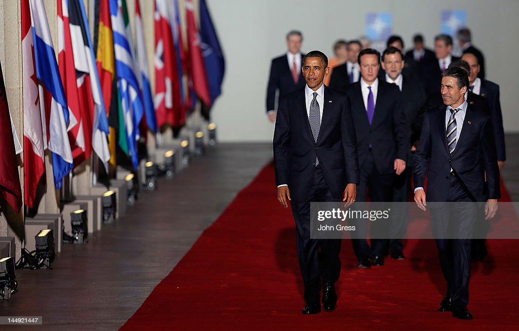 Secretary General Anders Fogh Rasmussen (R), U.S. President Barack Obama (L), and other world leaders arrive for a group photo at the NATO summit on May 20, 2012 at Soldier Field in Chicago, Illinois. As sixty heads of state converge for the two day summit that will address the situation in Afghanistan among other global defense issues, thousands of demonstrators have taken the streets to protest.