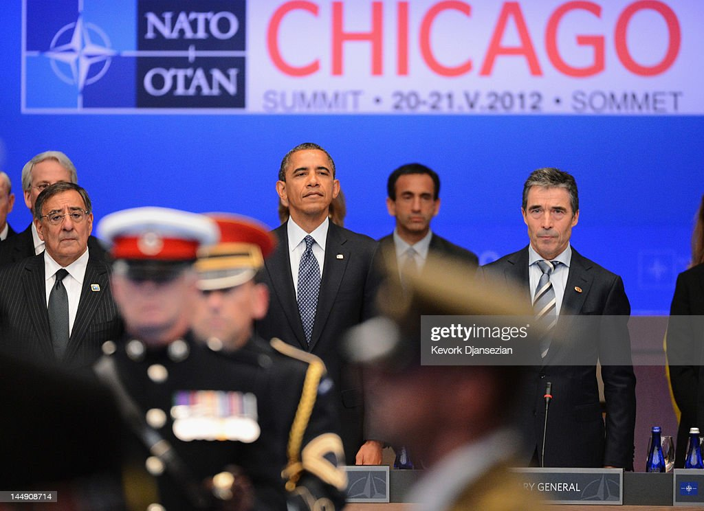Secretary General Anders Fogh Rasmussen (R), U.S. President Barack Obama (3rd R), his Defense Secretary Leon Panetta (4th R), stand for a moment of silence during the NATO summit on May 20, 2012 in Chicago, Illinois. As sixty heads of state converge for the two day summit that will address the situation in Afghanistan among other global defense issues, thousands of demonstrators have taken the streets to protest.