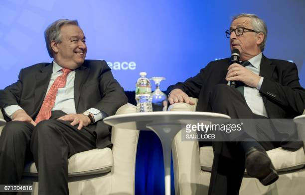 UN Secretary General Antonio Guterres looks on as European Commission President JeanClaude Juncker speaks during a panel discussion 'Financing For...