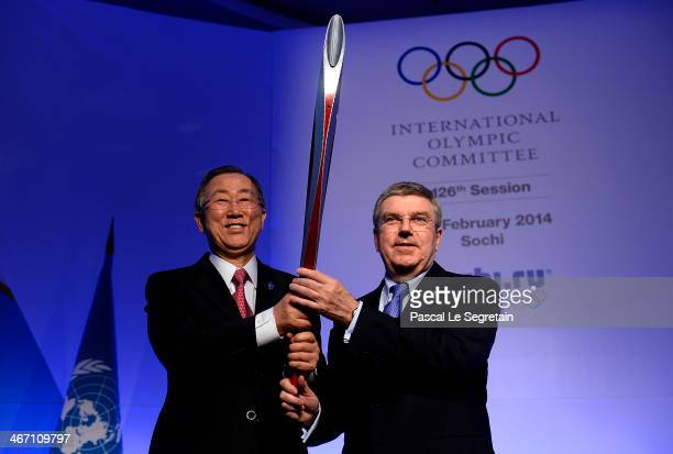 Secretary General Ban Kimoon and International Olympic Committee President Thomas Bach pose with the Olympic torch during a session of the IOC ahead...