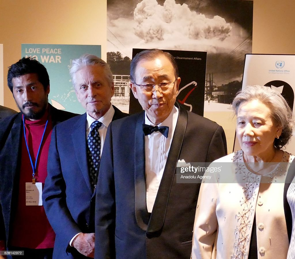 UN Secretary General Ban Ki-Moon (2nd R), his wife Ban Soon-taek (R), UN Messenger of Peace Michael Douglas (2nd L) and a winner of 'Disarmament Poster for Peace' competition pose for a photography during a reception, held for ranking the highest competitors of 'Disarmament Poster for Peace' competition at United Nations Office in New York, USA on May 4, 2016.