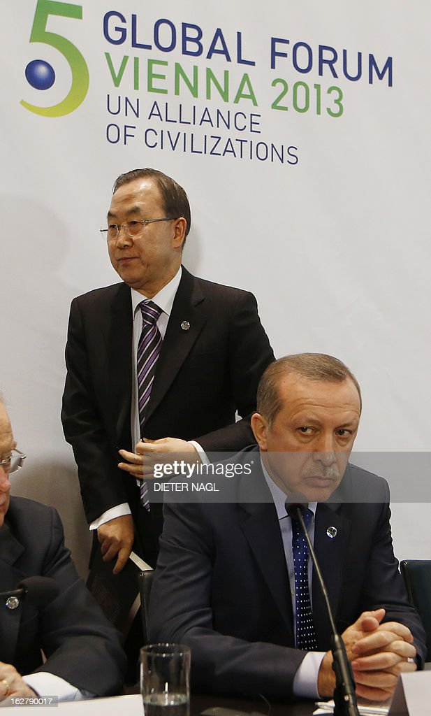 UN Secretary General Ban Ki-Moon (L) walks past Turkey's Prime Minister Recep Tayyip Erdogan (R, sitting) during the 5th Global Forum - UN Alliance of Civilizations on February 27, 2013 in Vienna. According to the organizers, the meeting running from February 27 to 28 brings together decision-makers, experts, and a variety of stakeholders in the field of intercultural and interreligious dialogue from all over the world.