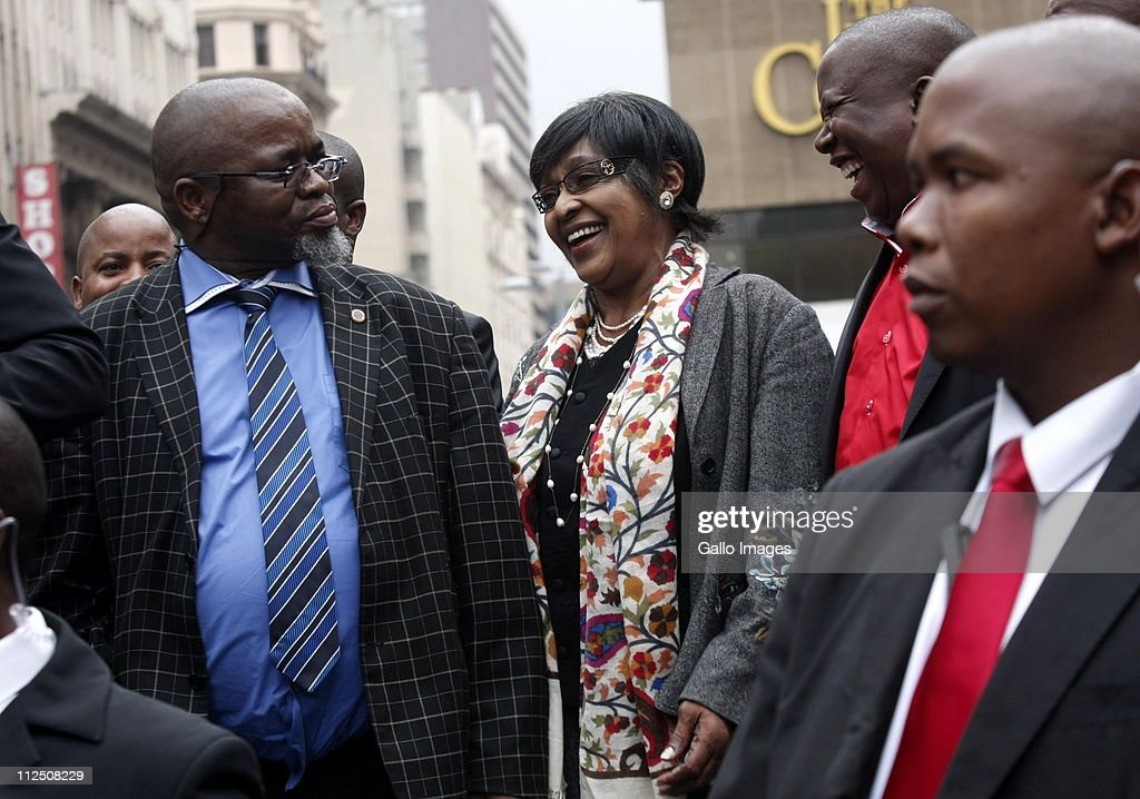 ANC Secretary General Gwede Mantashe ANC stalwart Winnie MadikizelaMandela and ANCYL President Julius Malema outside the Johannesburg High Court on...