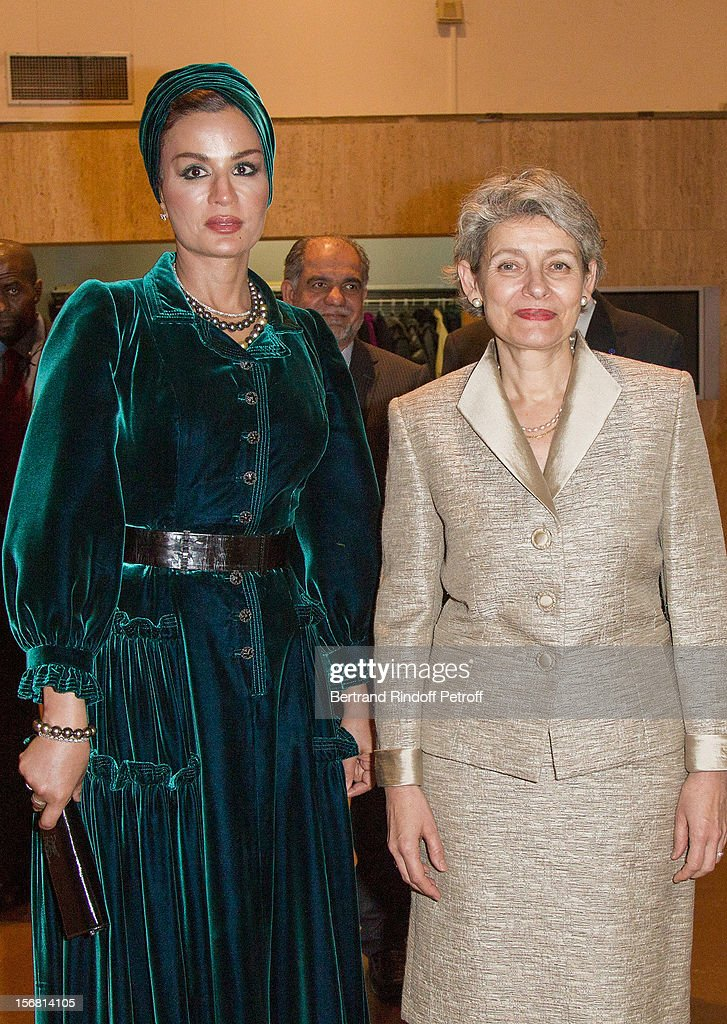 Secretary general <a gi-track='captionPersonalityLinkClicked' href=/galleries/search?phrase=Irina+Bokova&family=editorial&specificpeople=6324408 ng-click='$event.stopPropagation()'>Irina Bokova</a> (R) and Sheikha Mozah, the wife of the Emir of Qatar, attend Domingo's induction ceremony as Goodwill Ambassador of UNESCO, at UNESCO on November 21, 2012 in Paris, France.
