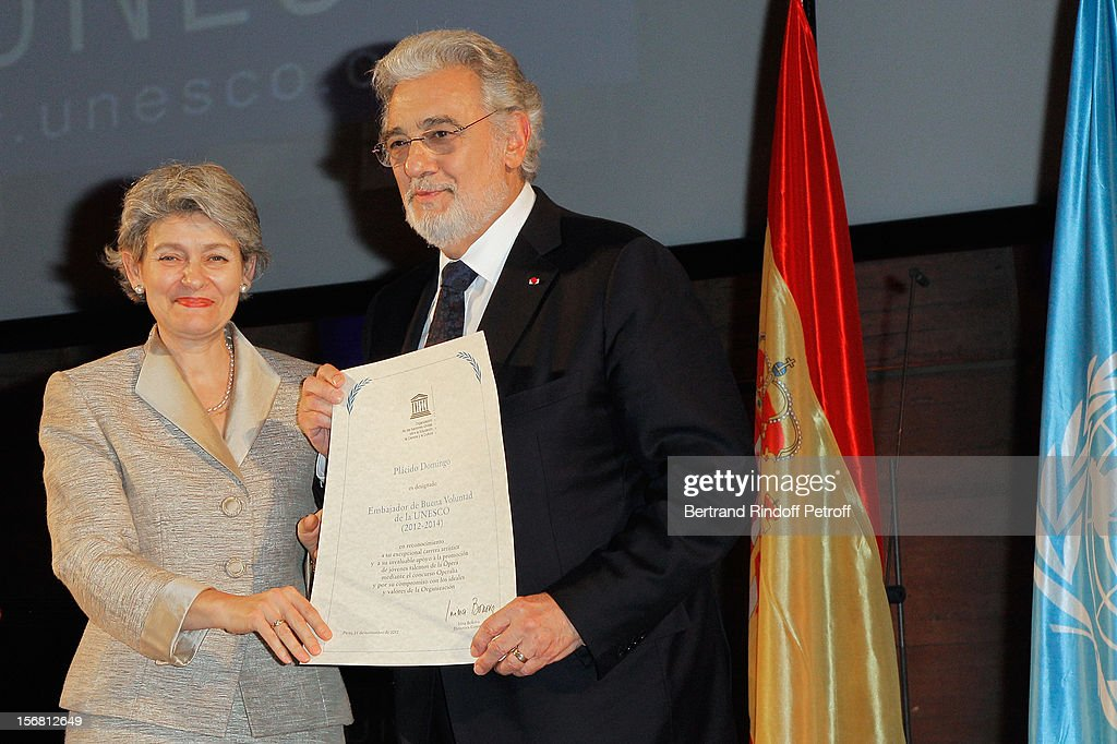 Secretary general <a gi-track='captionPersonalityLinkClicked' href=/galleries/search?phrase=Irina+Bokova&family=editorial&specificpeople=6324408 ng-click='$event.stopPropagation()'>Irina Bokova</a> (L) and world-famous tenor and conductor <a gi-track='captionPersonalityLinkClicked' href=/galleries/search?phrase=Placido+Domingo&family=editorial&specificpeople=204571 ng-click='$event.stopPropagation()'>Placido Domingo</a> hold Domingo's certificate as Goodwill Ambassador of UNESCO, during a ceremony at UNESCO on November 21, 2012 in Paris, France.