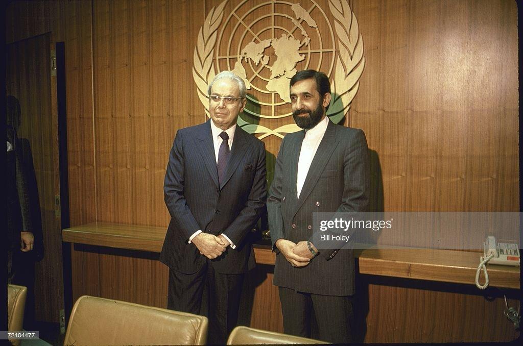 Secretary General Javier Perez de Cuellar posing with Iranian Foreign Minister Ali Akbar Velayati during the UN mediated IranIraq war peace talks