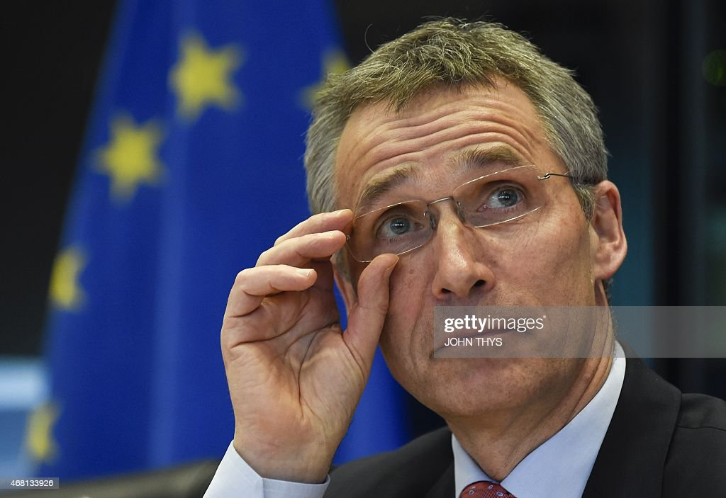 Secretary General Jens Stoltenberg adjusts his spectacles during a debate of the European Parliament Foreign Affairs Committee and its Subcommittee on Security and Defence, in Brussels on March 30, 2015. THYS