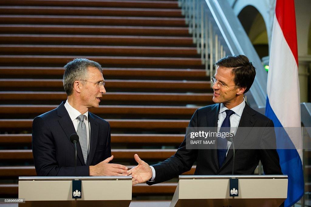 Maurits Hendriks Netherlands Prime Minister Mark Rutte L: Jens Stoltenberg