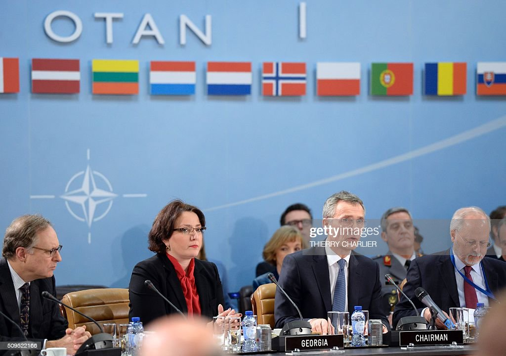 Secretary General Jens Stoltenberg (2nd R) and Georgian Defence Minister Tina Khidasheli (2nd L) take part in the NATO-GEORGIA Commission (NGC) meeting at the NATO headquarters in Brussels on February 11, 2016. / AFP / THIERRY CHARLIER