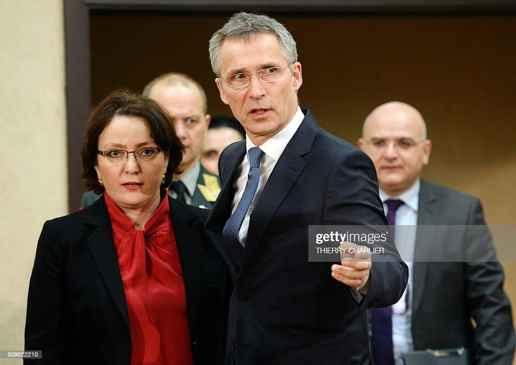 Secretary General Jens Stoltenberg (R) and Georgian Defence Minister Tina Khidasheli arrive for a NATO-Georgia Commission (NGC) meeting at the NATO headquarters in Brussels on February 11, 2016. / AFP / THIERRY CHARLIER