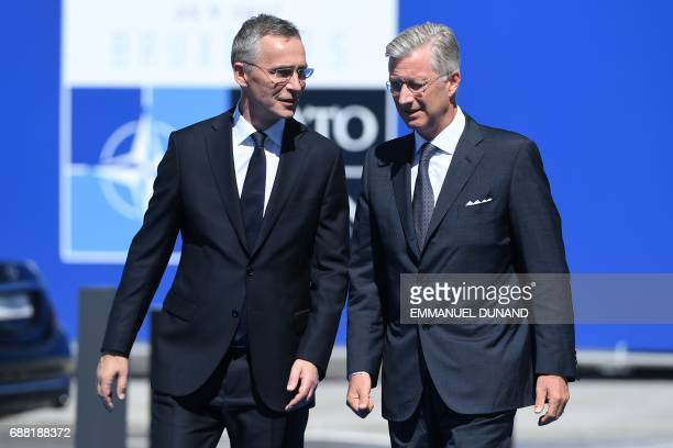Secretary General Jens Stoltenberg and King Philippe Filip of Belgium speak as they arrive for the NATO summit at the NATO headquarters in Brussels...
