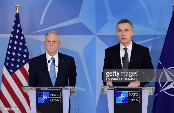 Secretary General Jens Stoltenberg and US Defence Minister James Mattis address the press during a NATO defence ministers' meetings at the NATO...