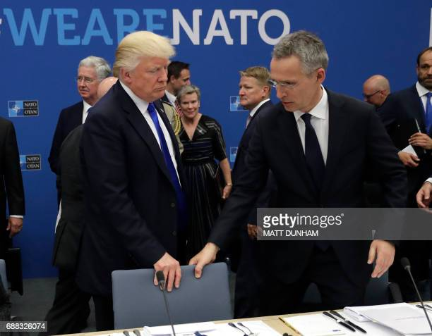 Secretary General Jens Stoltenberg and US President Donald Trump take a seat during a working dinner meeting at the NATO headquarters in Brussels on...