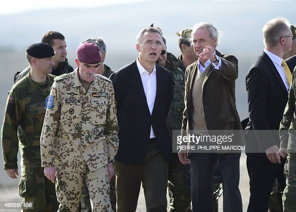 Secretary General Jens Stoltenberg flanked by German General and Commander Allied Joint Force Command Brunssum HansLothar Domroese speaks with...