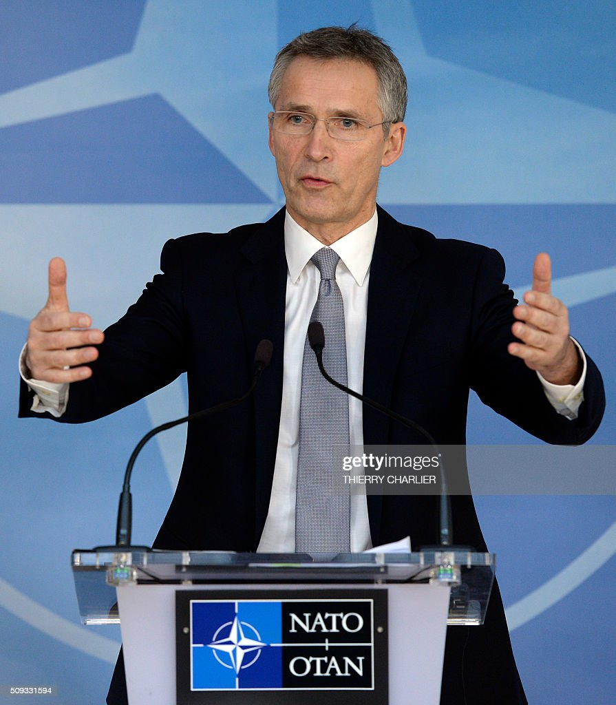 Secretary General Jens Stoltenberg gestures as he talks to the media prior to a meeting of the North Atlantic Council (NAC) of Defence Ministers at the NATO headquarters in Brussels, February 10, 2016. NATO defence ministers begin two-day meeting to discuss issues including Turkey's request for help to deal with the migration crisis, the alliance's beefed up response to a more assertive Russia and the security threat posed by the Syria war. / AFP / THIERRY CHARLIER