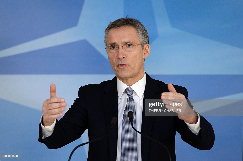 Secretary General Jens Stoltenberg gestures as he talks to the media prior to a meeting of the North Atlantic Council of Defence Ministers at the...