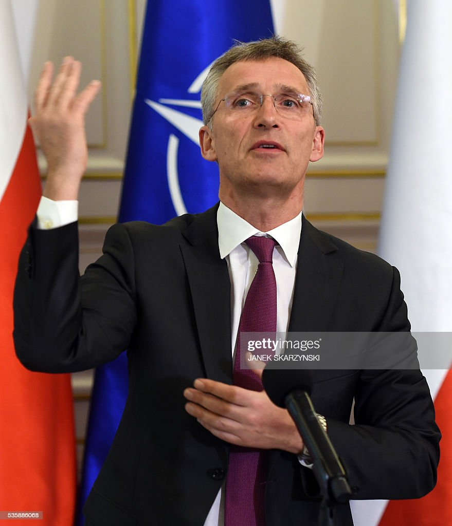 Secretary General Jens Stoltenberg gestures during a meeting with Polish President Andrzej Duda(not in a picture) on May 30, 2016 in Belweder palace in Warsaw. / AFP / JANEK
