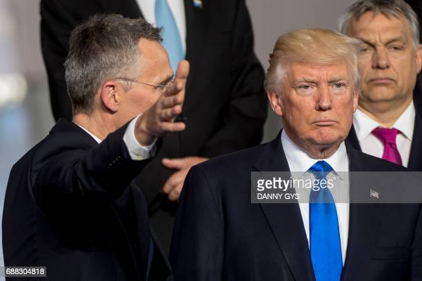 NATO Secretary General Jens Stoltenberg gestures next to US President Donald Trump and Prime Minister of of Hungary Viktor Orban during a family...