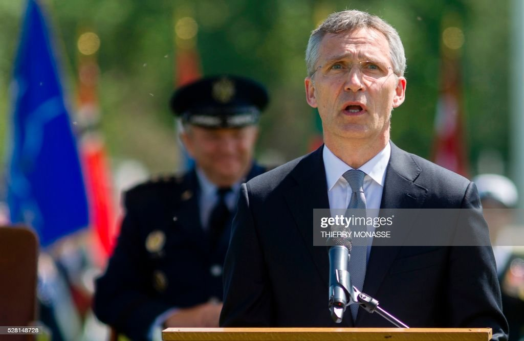 Outgoing NATO Secretary General Jens Stoltenberg (front) gives a speech in front of the new top commander General Curtis Michael Mike Scaparrotti (back) on May 4, 2016, during the change of command ceremony for NATOs Supreme Allied Commander Europe (SACEUR) at Supreme Headquarters Allied Powers Europe (SHAPE), in Mons. and General Curtis Mike Scaparrotti, the new top commander, give a joint press conference / AFP / Thierry Monasse