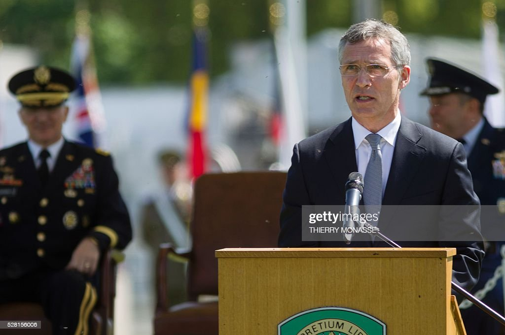 Secretary general Jens Stoltenberg (front) gives a speech in front of the new Supreme Allied Commander Europe (SACEUR) General Curtis Mike Scaparrotti (L) and the outgoing Supreme Allied Commander Europe (SACEUR) Philip Mark Breedlove (R) on May 4, 2016, during the change of command ceremony for NATOs Supreme Allied Commander Europe (SACEUR) at Supreme Headquarters Allied Powers Europe (SHAPE), in Mons. / AFP / Thierry Monasse