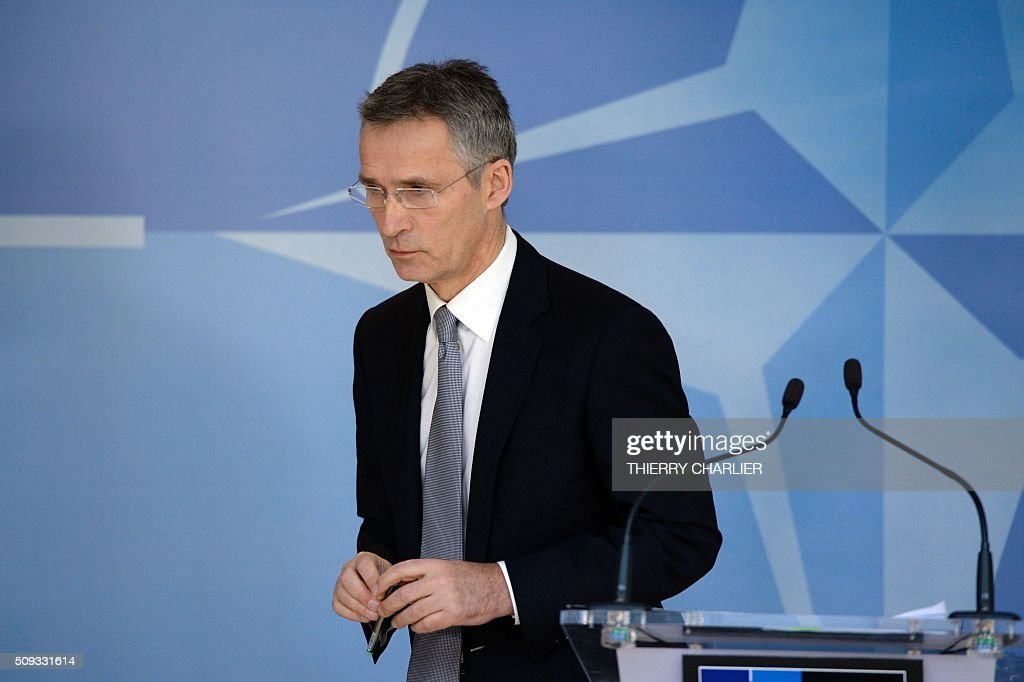 Secretary General Jens Stoltenberg leaves the podium after talking to the media prior to a meeting of the North Atlantic Council (NAC) of Defence Ministers at the NATO headquarters in Brussels, February 10, 2016. NATO defence ministers begin two-day meeting to discuss issues including Turkey's request for help to deal with the migration crisis, the alliance's beefed up response to a more assertive Russia and the security threat posed by the Syria war. / AFP / THIERRY CHARLIER