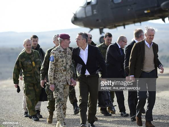Secretary General Jens Stoltenberg speaks with German General and Commander Allied Joint Force Command Brunssum HansLothar Domroese as they arrive...