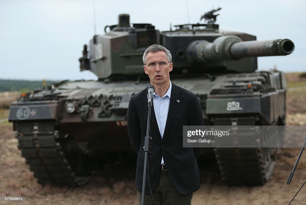 Secretary General Jens Stoltenberg stands in front of a Leopard tank of the Polish Army while speaking to the media during the NATO Noble Jump military exercises of the VJTF forces on June 18, 2015 in Zagan, Poland. The VJTF, the Very High Readiness Joint Task Force, is NATO's response to Russia's annexation of Crimea and the conflict in eastern Ukraine. Troops from Germany, Norway, Belgium, Poland, Czech Republic, Lithuania and Belgium were among those taking part today.