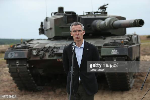Secretary General Jens Stoltenberg stands in front of a Leopard tank of the Polish Army while speaking to the media during the NATO Noble Jump...