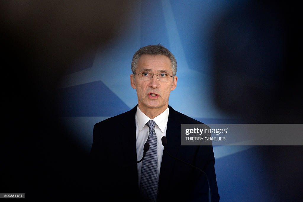 Secretary General Jens Stoltenberg talks to the media prior to a meeting of the North Atlantic Council (NAC) of Defence Ministers at the NATO headquarters in Brussels, February 10, 2016. NATO defence ministers begin two-day meeting to discuss issues including Turkey's request for help to deal with the migration crisis, the alliance's beefed up response to a more assertive Russia and the security threat posed by the Syria war. / AFP / THIERRY CHARLIER