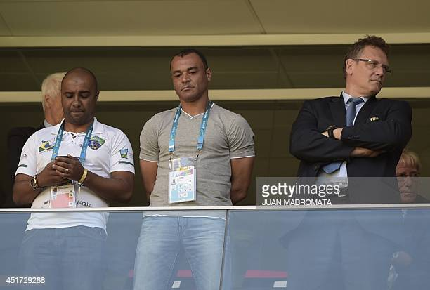 Secretary General Jerome Valcke and Brazilian former player Cafu attend the quarterfinal football match between Argentina and Belgium at the Mane...