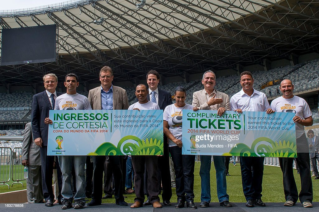 Secretary General Jerome Valcke, Brazil's Sports Minister Aldo Rebelo (C) and LOC member Ronaldo Nazario (2R) give a giant-sized symbolic ticket to four construction workers involved in the construction of Mineirao Stadium during the 2014 FIFA World Cup Host City Tour on March 6, 2013 in Belo Horizonte, Brazil.