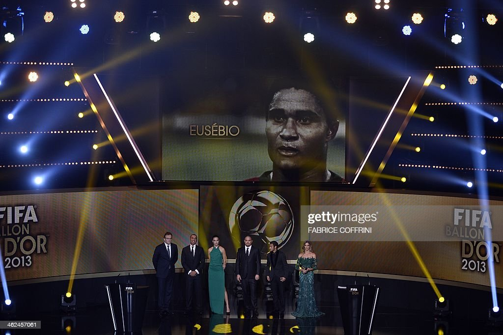 FIFA secretary general Jerome Valcke, former Dutch football player and presenter Ruud Gullit, Brazilian model Adriana Lima, Brazil's former striker Ronaldo, Barcelona's Brazilian forward Neymar and Brazilian presenter Fernanda Lima pay tribute to late Portuguese football legend Eusebio during the FIFA Ballon d'Or award ceremony at the Kongresshaus in Zurich on January 13, 2014.