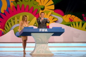 Secretary General Jerome Valcke holds up the name of Australia during the Final Draw for the 2014 FIFA World Cup Brazil at Costa do Sauipe Resort on...