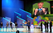 Secretary General Jerome Valcke holds up the name of Germany during the Final Draw for the 2014 FIFA World Cup Brazil at Costa do Sauipe Resort on...