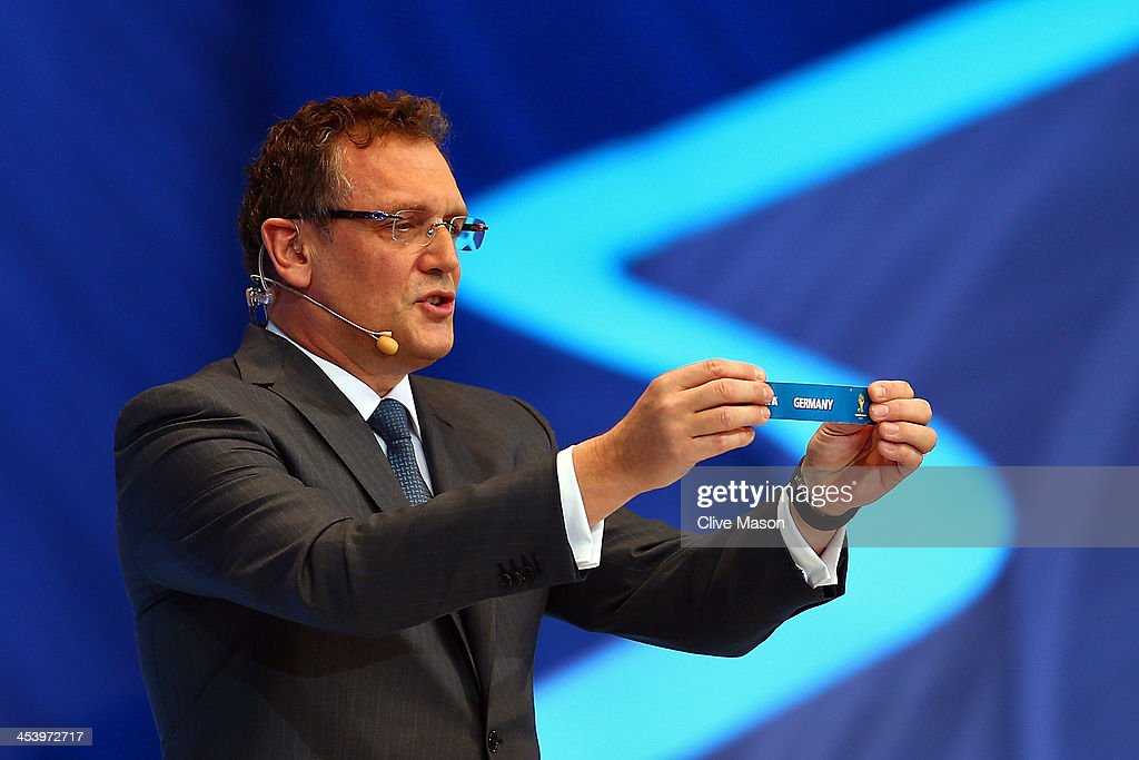Secretary General <a gi-track='captionPersonalityLinkClicked' href=/galleries/search?phrase=Jerome+Valcke&family=editorial&specificpeople=4375385 ng-click='$event.stopPropagation()'>Jerome Valcke</a> holds up the name of Germany during the Final Draw for the 2014 FIFA World Cup Brazil at Costa do Sauipe Resort on December 6, 2013 in Costa do Sauipe, Bahia, Brazil.