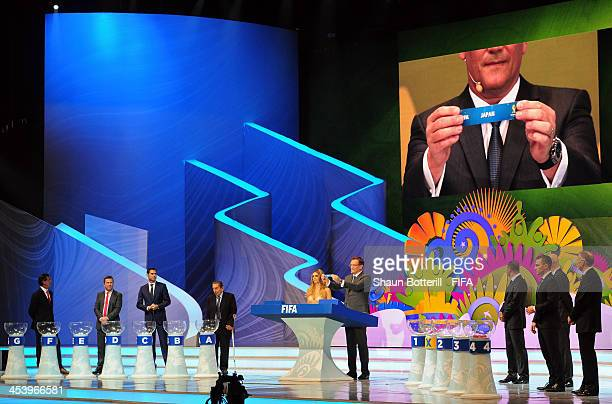 Secretary General Jerome Valcke holds up the name of Japan during the Final Draw for the 2014 FIFA World Cup Brazil at Costa do Sauipe Resort on...
