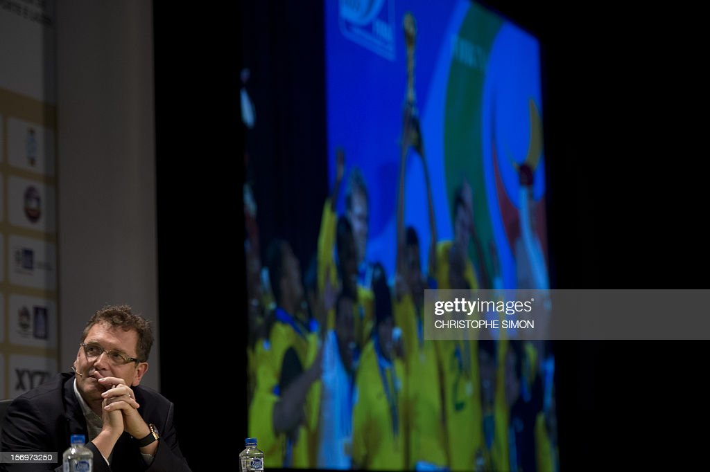FIFA secretary general Jerome Valcke looks at images on a screen (out of frame) during an interview with Globo journalist after the opening ceremony of the Soccerex football convention, in Rio de Janeiro, Brazil, on November 14, 2012. Soccerex is the leading event provider for the global football industry. AFP PHOTO/Christophe Simon