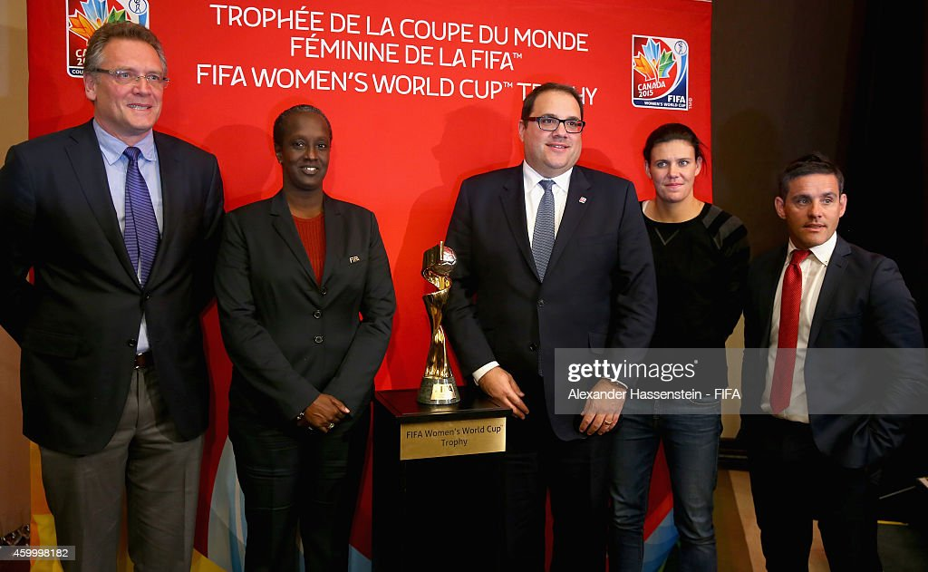 Secretary General Jerome Valcke, Lydia Nsekera, Executive Committee co-opted Member and President of the Burundi Football Federation, Victor Montagliani, Chairman of the National Organising Committee (NOC) for the FIFA Woman`s World Cup 2015 and Canadian Soccer Association President, Christine Sinclair and Canada head coach John Herdman pose after the official Pre-Draw press conference at The Westin Hotel on December 5, 2014 in Ottawa, Canada.